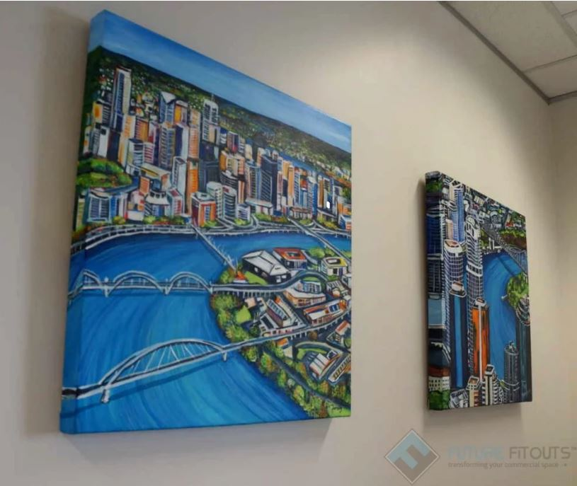 Artwork hanging on a white wall | Featured image for 5 affordable office design ideas blog.