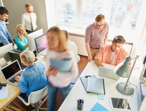 People working in an office | Featured image for managing interruptions at work blog.